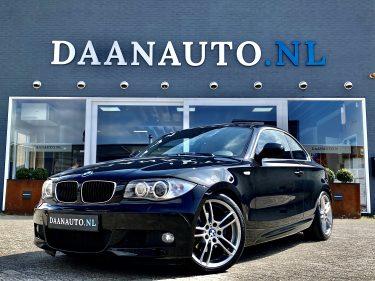 BMW 1-serie 125i Coupé High Executive M-Sport 2010 zwart occasion te koop kopen heemskerk beverwijk Amsterdam